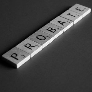"photo of scrabble letters spelling ""probate"" on gray surface"